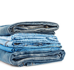 Stack of jeans trousers isolated on white background