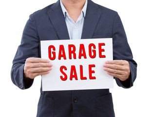 Business man hold garage sale banner isolated on white backgroun