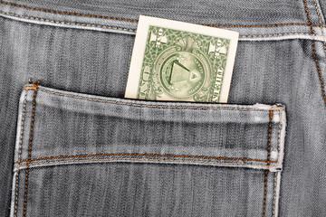 One dollar bill sticking in the back pocket of denim  black jean