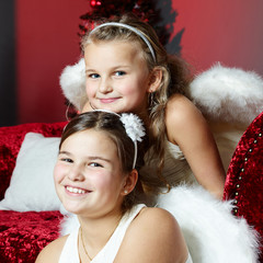 Two girls look forward to Christmas Eve