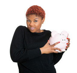 Woman holding piggy bank, protecting her only savings
