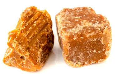 Jaggery cane sugar isolated on white