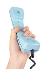Retro telephone handset in hand, isolated on white