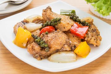 Stir fried fish in black pepper sauce on dish