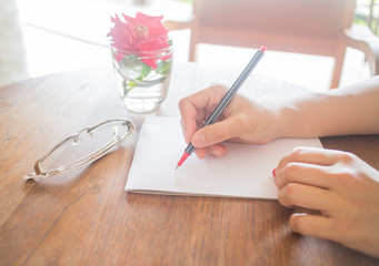 Writing love letter on romantic table