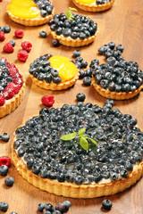 Fruit tart dessert with raspberries blackberries and cranberries