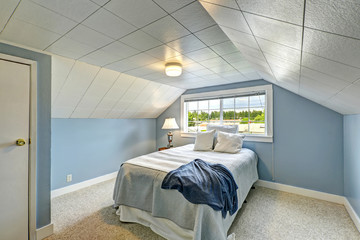 Light blue bedroom. Countryside house interior
