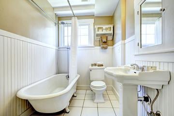 Claw foot tub in white bathroom