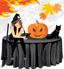 Halloween witch with a bat, cat and pumpkin sitting on the table