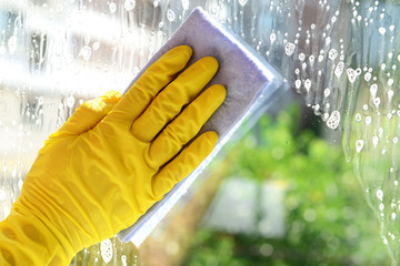 Cleaning windows with special rag
