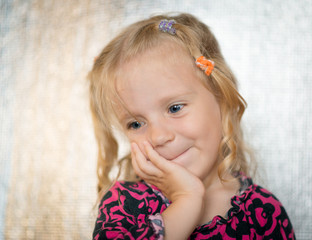 Cute little girl over bright background.
