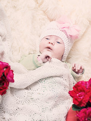 baby with roses