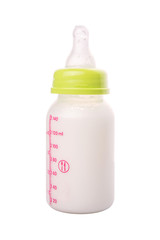 Milk in a baby bottle over white background