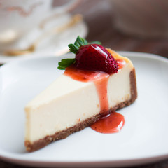 Strawwberry cheesecake on rustic background