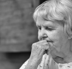 Senior thoughtful woman.