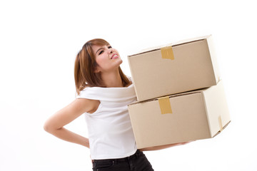 unhappy woman carrying heavy box with back pain