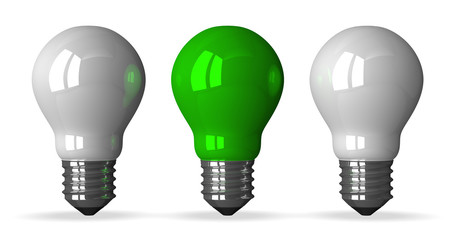 Green tungsten light bulb and two white ones, front view