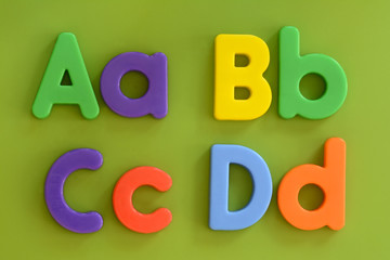 Close up of Aa, Bb, Cc, Dd, in colorful plastic letters