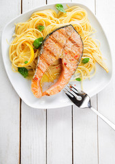 Gourmet seafood cuisine with grilled salmon