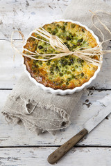 vegetables french quiche with peas on baking dish