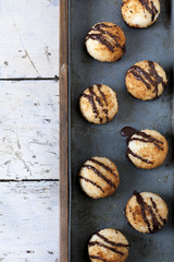 coconut macaroons with dripped chocolate on vintage tray