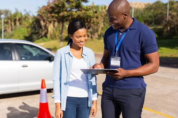 Fototapete - african learner driver with instructor