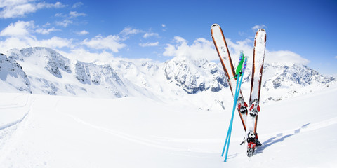 Wall Mural - Skiing , mountains and ski equipments on ski run