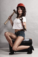Sexy girl mechanic working with tools.