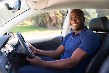 Fototapete - african man inside his new car