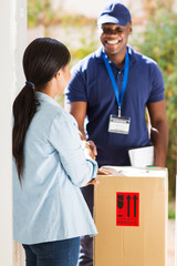 african delivery man handshaking with customer