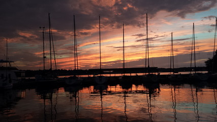 Sunset over a lake with sailboats