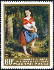 stamp shows girl in the forest, by Miklos Barabas