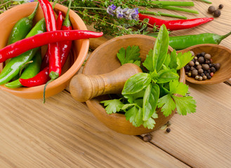 Herbs and peppers on  wooden background