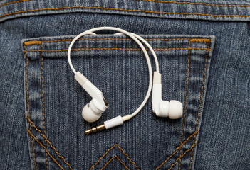 Vacuum headphones white in jeans pocket