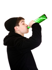 Teenager drinks a Beer