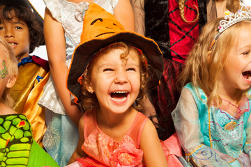 Laughing girl in Halloween costume with friends
