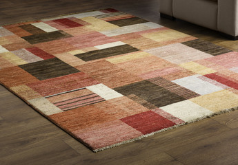 Rug carpet on wooden floor close up