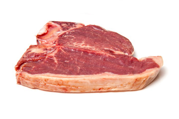T-bone steak isolated on a white studio background.
