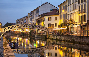 Fototapete - Bridge across the Naviglio Grande canal