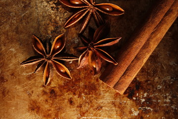 close up of star anise and cinnamon on old vintage metal desk