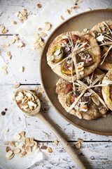homemade rustic cookies with figs and almond slices on plate