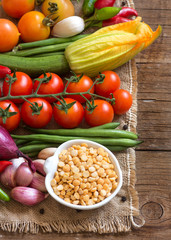 Raw Organic yellow peas and vegetables