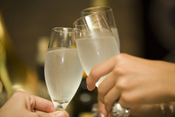 Female hand to toast with champagne