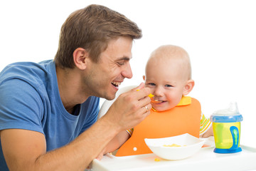 father feeding kid son