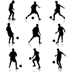 silhouettes of soccer players with the ball.