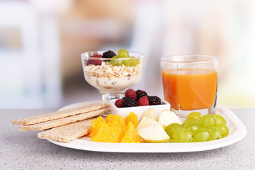 Slices of fruits with berries and muesli