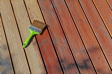 painting wooden patio deck with protective oil