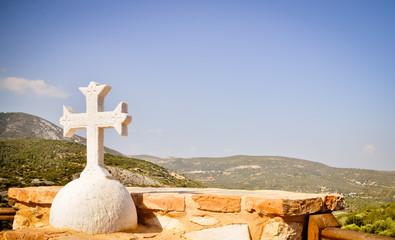 Orthodox cross and Mediterranean landscape
