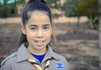 A happy Israel Girl Scout on the way to summer camp