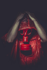 chemical nuclear concept, man with red gas mask